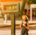 Woman suffers from heat and sunstroke outside in hot weather on the background of a street thermometer showing 39 degrees Celsius