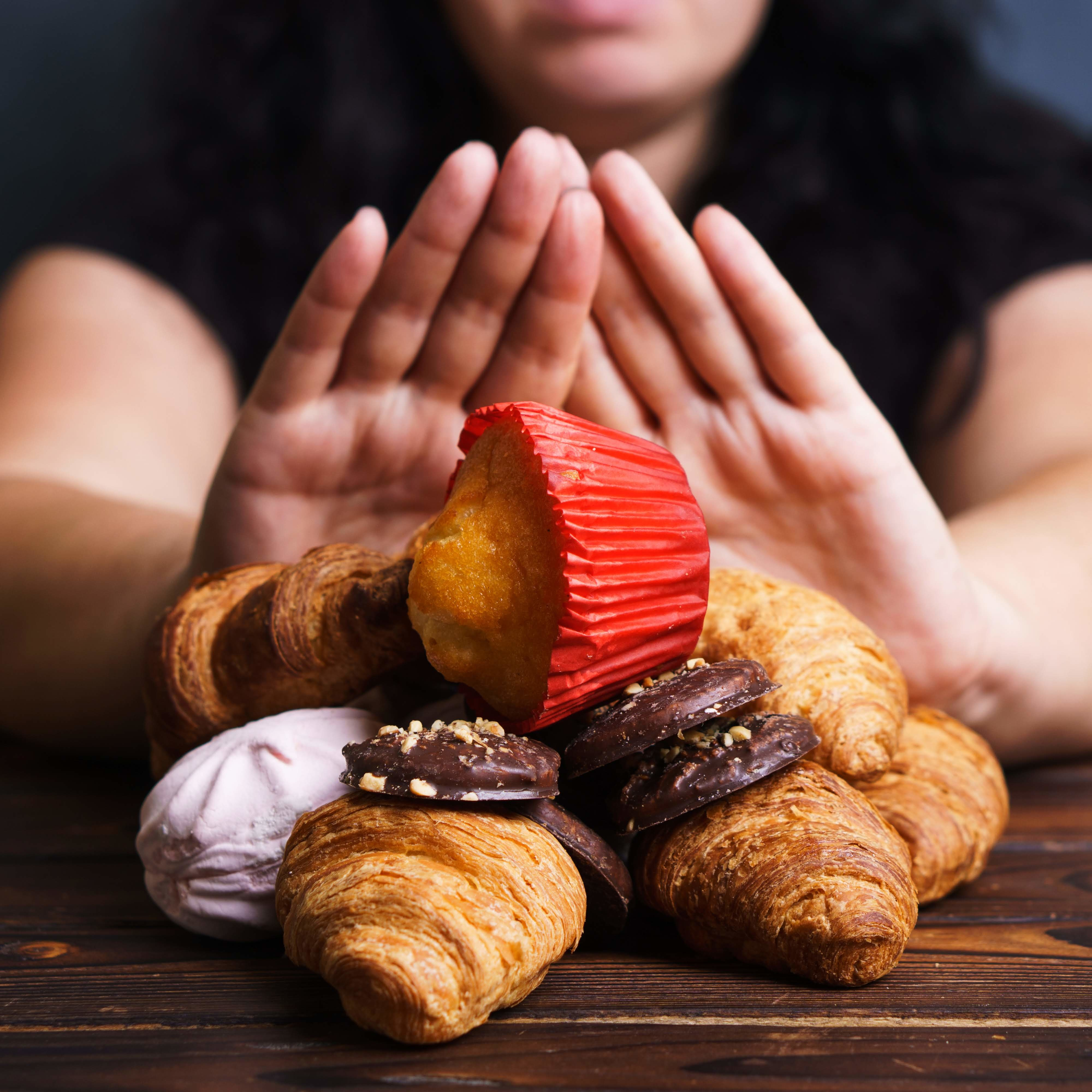 Obesity prevention, conscious eating, nutrition choices, mindfulness and healthy lifestyle. Addicted woman refuse to eat sweets, close up